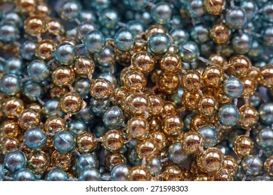 Background of golden and blue glass shiny large beads