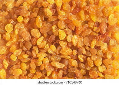 Background with golden raisins. Food texture. Top view