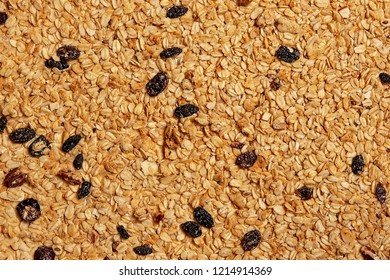 background of granola with nuts and raisins. texture of oat granola. flat lay, top view
