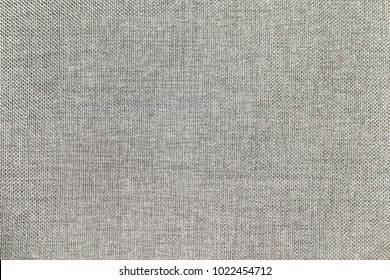 Background of gray synthetic fabric. Close up