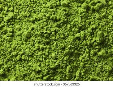 Background of green powder surface close up macro shot
