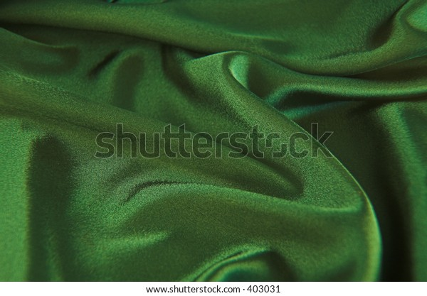 A background of green satin