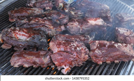 Chef Cooking Delicious Beef And Pork Barbecue On Grill