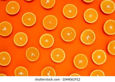 Background of half cut oranges on orange background
