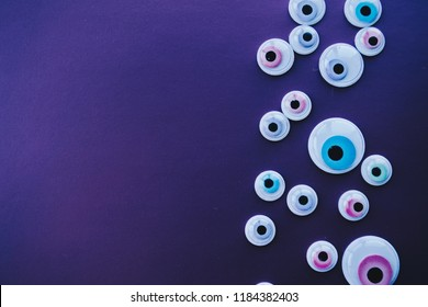 Background for Halloween. Plastic Eye Stickers. Googly Eyes.