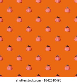 Background for halloween or for wrapping paper. Seamless pumpkin pattern on an orange background. An image of a pumpkin with a witch's hat. Grooves on the ceramic pumpkin