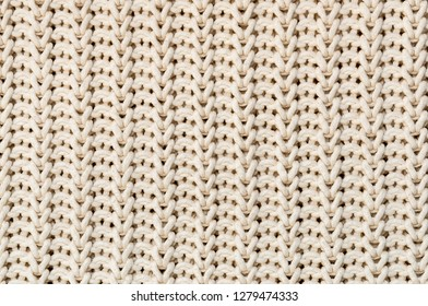 Background of Handmade Knitted fabric of cotton White Cream color, cloth knitted texture.