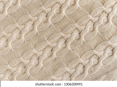 Background of Handmade Knitted fabric of wool White Cream color, cloth knitted texture.