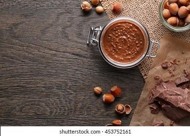 Background with hazelnut spread and ingredients