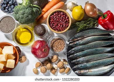 Background of healthy food with blue fish and vegetables and superfood. Soft focus, Free copy space.