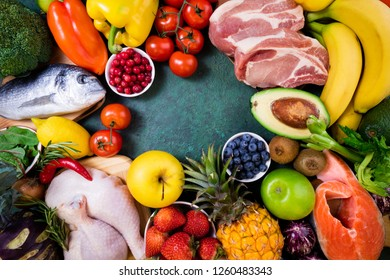 Background healthy food. Fresh fruits, vegetables, meat and fish on table. Healthy food, diet and healthy life concept. Top view, copy space