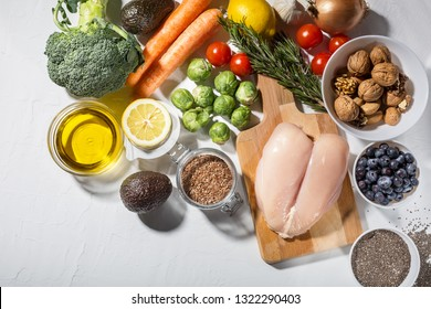 Background of healthy food with white meat, vegetables and superfood. Soft focus, Free copy space. Clean eating and keto diet concept.