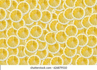 background of heap fresh yellow lemon slices. Close-up. Studio photography.