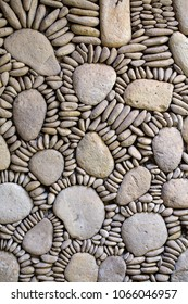 Background from high detailed fragment pebble stone wall texture, close up