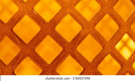 A background with a high resolution metal grille of orange color