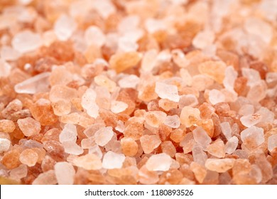 background of Himalayan salt - pink and orange coarse crystals, selective focus