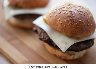 background of homemade buns with sesame and hamburgers. made at home bread. natural product. life style