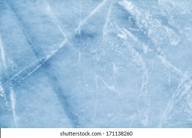 A background of ice surface cut with skate scratches
