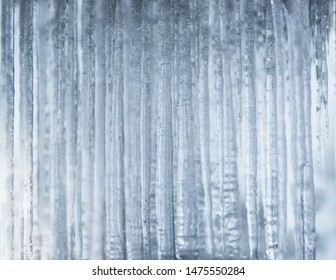 Background with icicles in shades of blue