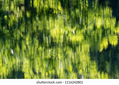 Background image with abstract green water reflections