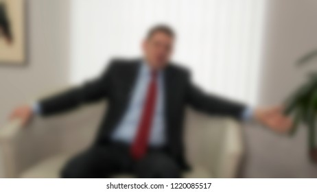 Background image, blur. Politician, congressman gives an interview in his office.