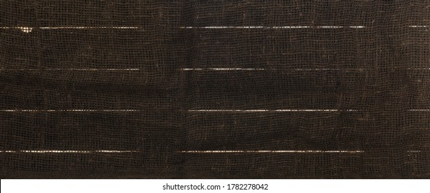 Background image of boards with slits and dark burlap
