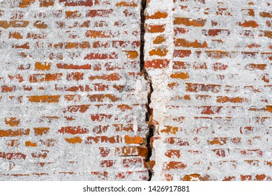 Background with the image of a brick wall with a crack