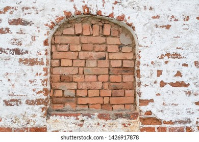 Background with the image of a brick wall with an immured window