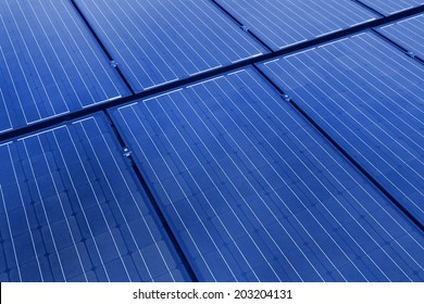 Background image with close-up of solar panels