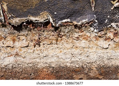 background image of a corroded rusted and mineralized evaporative cooler water reservoir