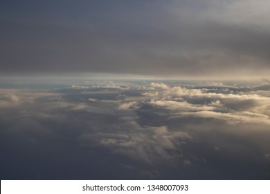 Background image flying above the clouds with dark sky.