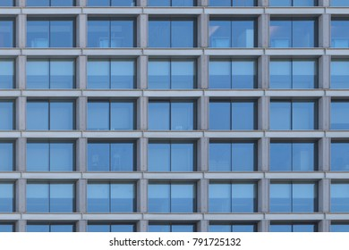 Background image of a glass windows facade of an office building.