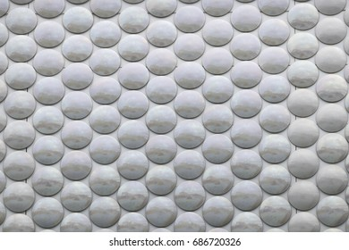 Background image of grey surface with silver reflective circles.