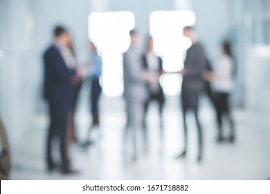 background image of a group of corporate employees in the office lobby