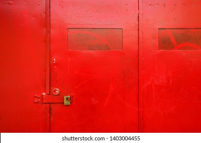 Background image of heavy mettalic door paind red with padlock