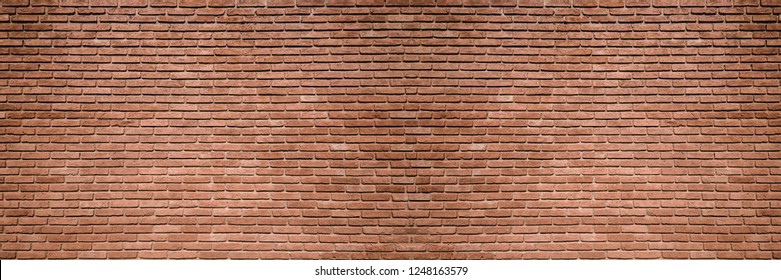 Background image of a large brick wall. High resolution image of a rustic wall.