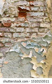 Background image of an old brick wall with peeling plaster.