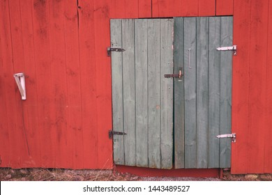 Background image of old red barn with green wooden doors