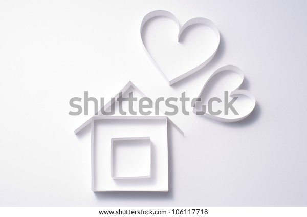 a background image of paper craft's heart and house