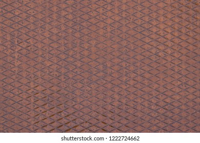 Background image of rusty metallic suface with a rhombus pattern.
