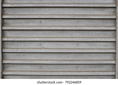 Background image of a sheet of iron with horizontal stripes.