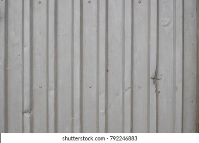 Background image of a sheet of iron with vertical stripes.