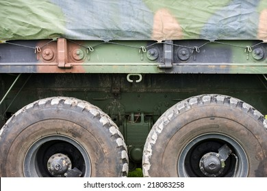 A background image the side of a Army military personnel transport truck.