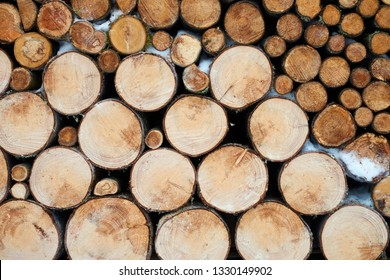 Background image of stacked, dry chopped logs used for firewood. Pile of logs ready to be used in fireplace. Alternative warming method. Natural energy.