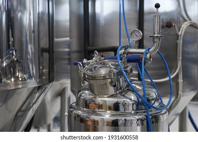 Background image of steel tanks and equipment in industrial workshop, copy space