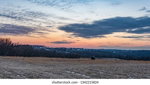 Background image of sunset on a ridgetop in rural Appalachia during March.