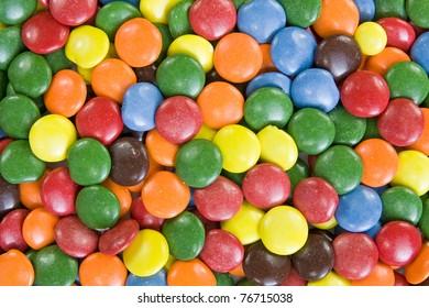 Background image of sweet smarties or chocolate buttons.