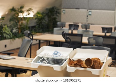 Background image of two waste sorting containers for plastic and cardboard on desk in modern office interior, copy space