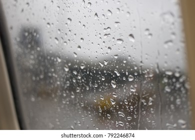 Background image of a window full of raindrops.