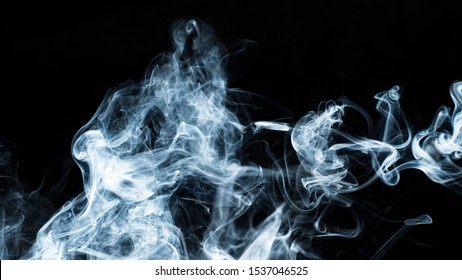 Background image of a wisp of smoke on a dark background. Frozen smoke on a dark background. Graphic resources dark backdrop. Texura of white clouds of fog. Curls of smoke frozen in motion.